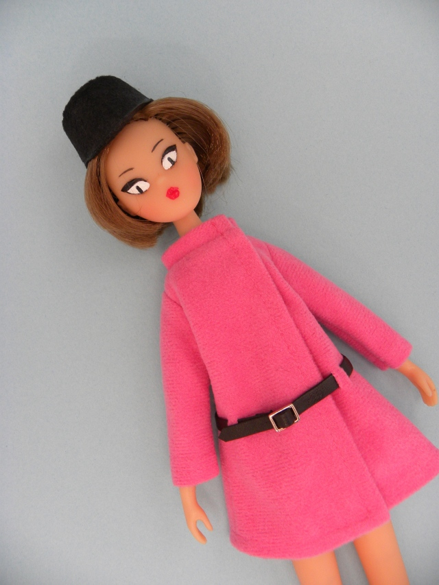 A tiny hat and a pink coat set
