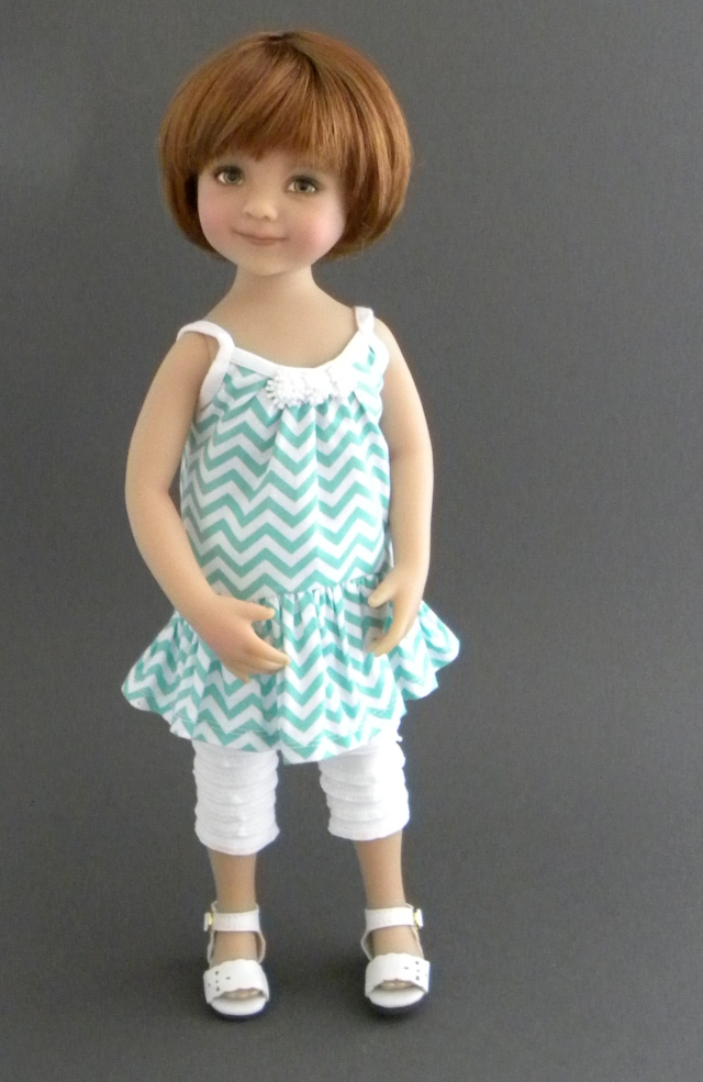 Matilda models the chevron tunic dress with ruffled leggings